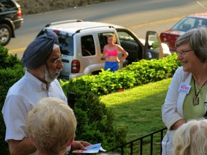 Mayor Satyendra Huja welcoming Sister Simone Campbell, SSS, and the Nuns on the Bus to the City of Charlottesville