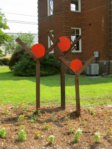 """Steel sculpture of Habitat for Humanity """"Family"""" Logo, made from old trailer's I-Beams"""