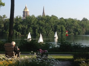 Fr. Ted Hessburgh enjoying view of St. Joseph Lake from Holy Cross House at age 96.