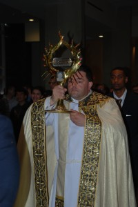 Fr. Gregory Gresko carrying the First Class Relic the Blood of Saint John Paul II