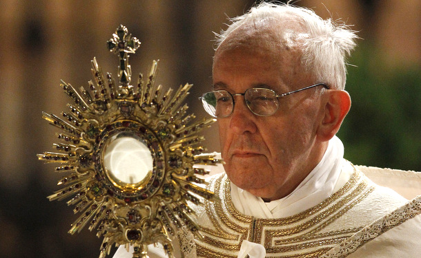 Pope Francis carries a monstrance holding the Blessed Sacrament during the Corpus Christi  Rome. (CNS photo/Paul Haring)