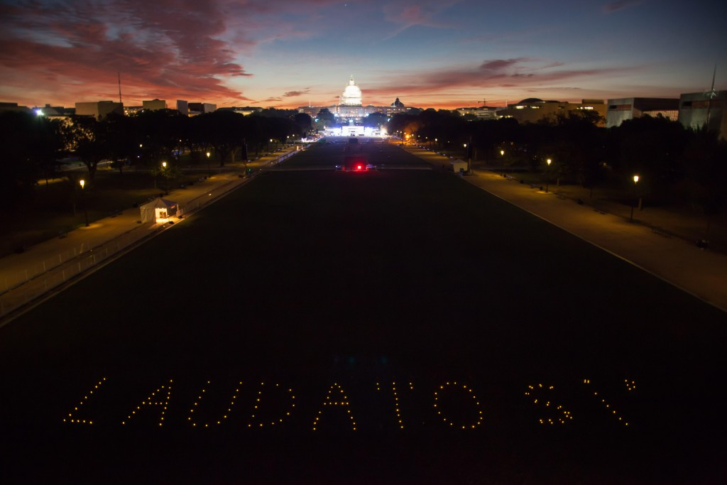 The Franciscan Action Network, Catholic supporters, and community members gathered at sunrise with candles and lights to form the image of 'Laudato Si' (Praise Be - title of the Pope's encyclical) on the National Mall hours before he speaks to Congress. The event organizers call for support of the Pope's goals on climate change and poverty. Photo Credit: John Quigley / Spectral Q
