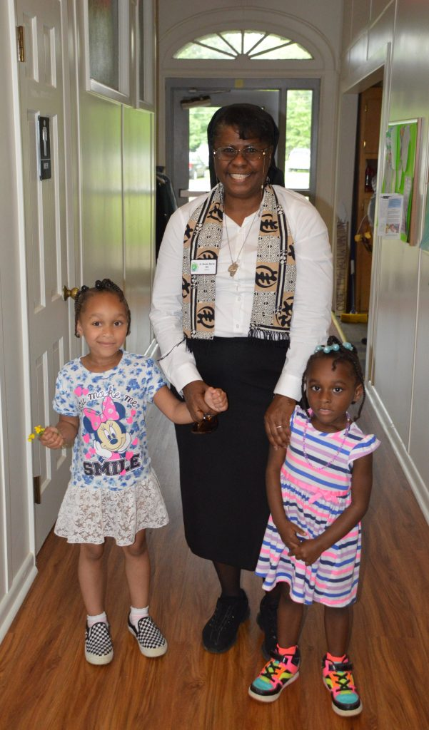 Sister Beulah with two of her preschool students.