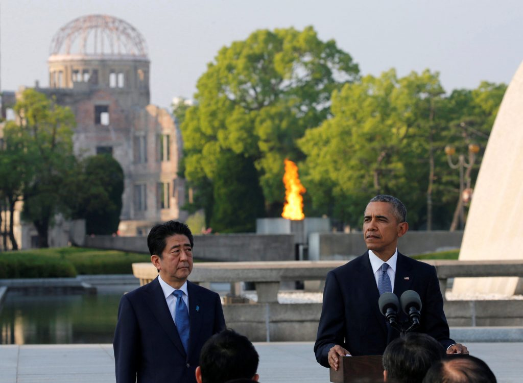 U.S. President Barack Obama (R), flanked by Japanese Prime Minister Shinzo Abe, delivers a speech as the atomic bomb dome is background after they laid wreaths to a cenotaph at Hiroshima Peace Memorial Park in Hiroshima, Japan May 27, 2016. REUTERS/Carlos Barria - Renewal of efforts on working toward Nuclear Disarmament