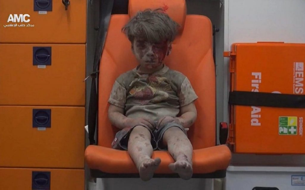 His face bloodied and completely covered in dust, the little boy sits quietly, staring ahead, dazed and shocked after an apparent air strike in the Syrian city of Aleppo. Alone in an ambulance, the boy - identified by doctors as five-year-old Omran Daqneesh - tries to wipe the blood off his head, unaware of the injury he has sustained. (Rueters)