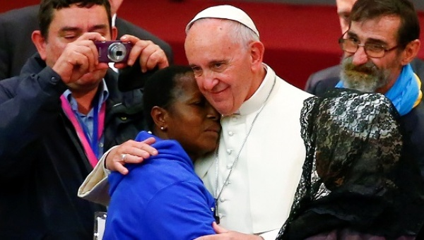 Pope Francis embraces a woman during a Jubilee audience with people socially excluded in Paul VI Hall.
